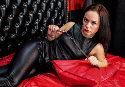 strict mistress showing off her whip