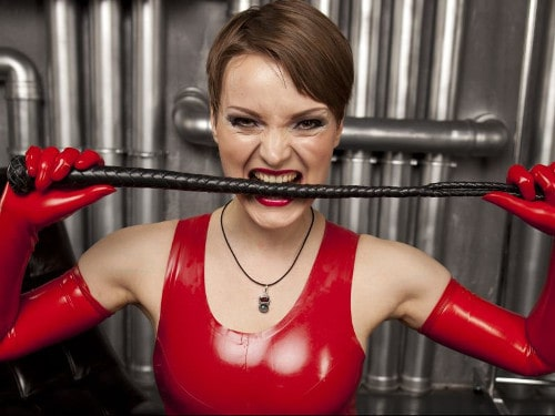 latex queen ready with whip