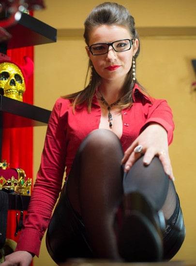 nerdy femdom mistress showing her heeled feet