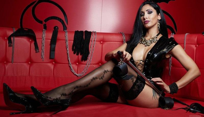 brunette femdom mistress teasing long legs in stockings