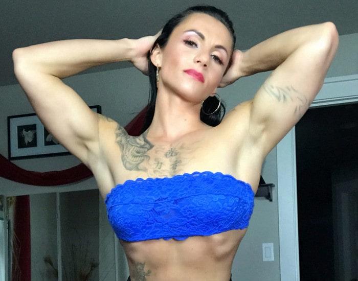 femdom muscle mistress flexing arms