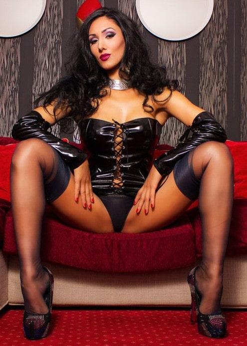 femdom mistress spreading legs in stockings & heels