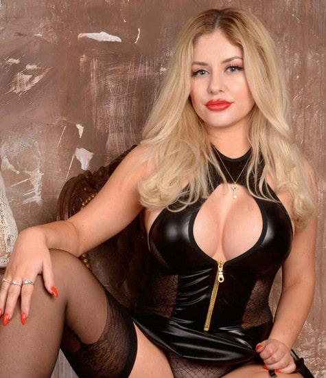 buxom fetish mistress teasing leather bodysuit
