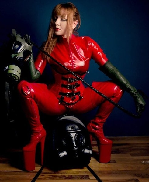 redhead mistress posing red latex body suit