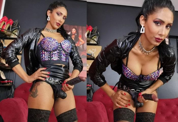 brunette strapon mistress wearing BBC dildo