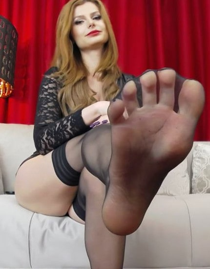 sexy foot mistress flashing sole in stockings