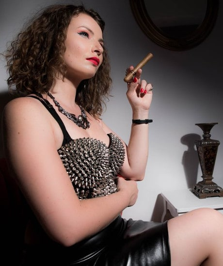 spiked bra mistress smoking cigar
