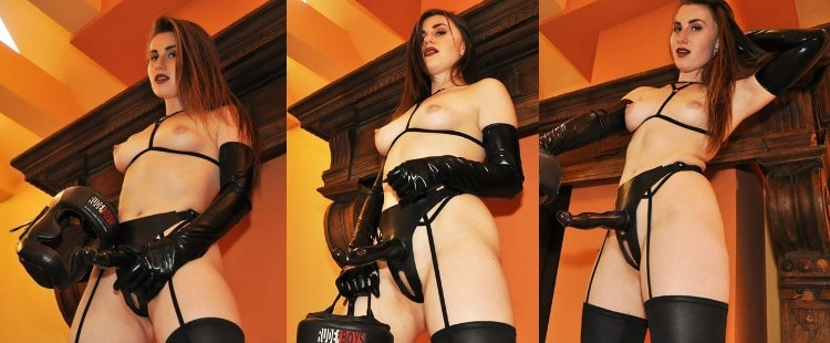 topless strapon mistress posing with her dildo ready