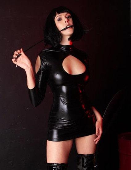 fetish mistress in latex dress holding whip
