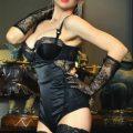 blonde dominatrix wearing lingerie