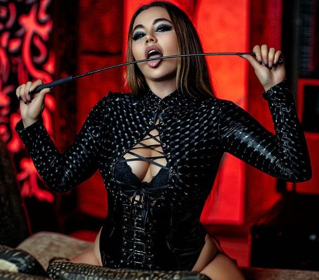 whip mistress licks her whip