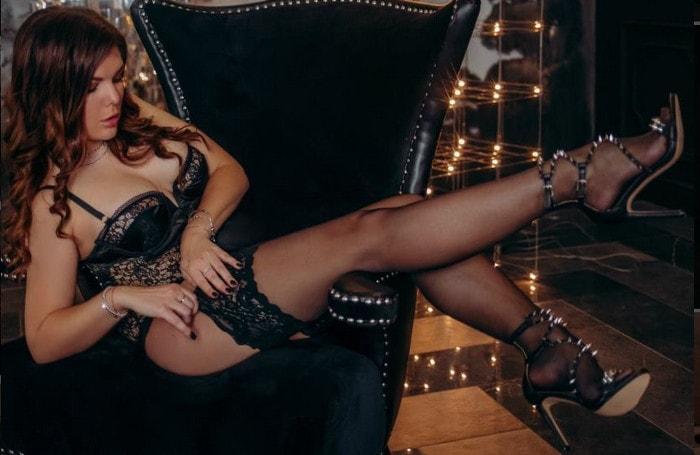 redhead money mistress teasing stockings & spiked heels