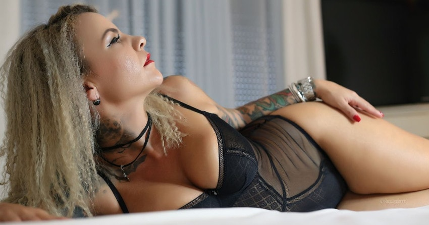 tattoed blonde lounging in lingerie