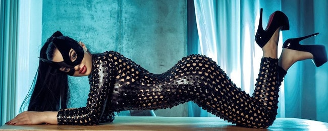 rubber mistress wearing rubber, mask, heels