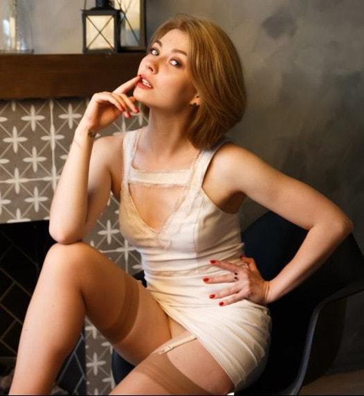 hot blonde posing in stockings & garters