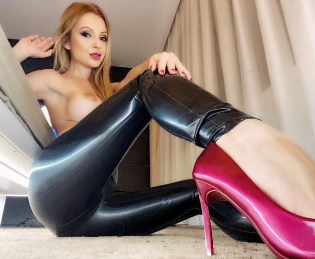 topless femdom mistress wearing leather pants & heels